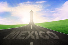 Highway with word of Mexico and arrow upward Stock Photo