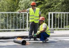 Highway workers waterproof bridge Welding Torch fire Stock Image