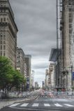 Highways Between Brown High Rise Building during Daytime Royalty Free Stock Photography