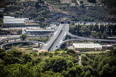 Highways intersection among hills Stock Photos
