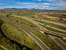 Highways in North Denver. An aerial view of several highways in North Denver with mountains in the background stock photos