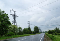 Highways passing under power lines. Stock Image