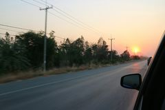 Highways road. Road tolls, highways, evening skies, sunsets to fall stock photo