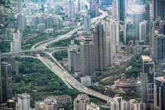Highways surrounded by green parks and high-rise buildings. In Shanghai, China Royalty Free Stock Photo