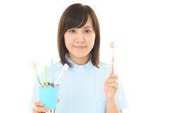 Higienista dental de sorriso imagem de stock royalty free