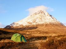 Higland in Scotland. Marvelous day  at frozen river Coupall at delta to river Etive. Snowy cone of mountain Stock Photo