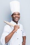 Hij is een kampioen in de keuken stock foto's