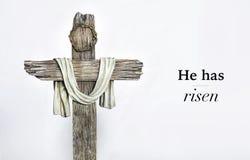 Hij is kruis en woorden toegenomen royalty-vrije stock afbeeldingen