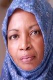 Hijab. African American woman wearing blue headscarf stock photography