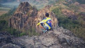 Climbing on peak of rock mountain royalty free stock photography