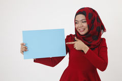 Hijab holding and pointing to the card Stock Images