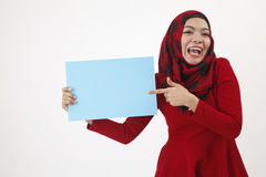 Hijab holding and pointing to the card Stock Photography