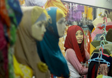 Hijab store. A woman action when waiting costumer at hijab store, Pasar Klewer, Central Java, Indonesia Stock Photography