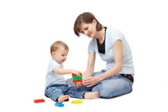 Hijo que juega con la madre Fotos de archivo
