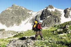 In hike. Boy backpacker  in hike on Caucasus Stock Photo