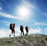 Hike. Backpackers in  hike for sunny weather Royalty Free Stock Image