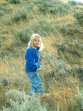 Hike On. Girl hiking in prairie hills Royalty Free Stock Image