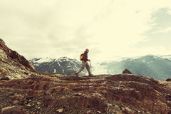 Hike in Canada. Hiking man in Canadian mountains. Hike is the popular recreation activity in North America. There are a lot of picturesque trails Stock Photography