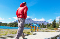 Hike in Canada. Hiking man in Canadian mountains. Hike is the popular recreation activity in North America. There are a lot of picturesque trails Royalty Free Stock Photo
