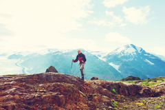 Hike in Canada. Hiking man in Canadian mountains. Hike is the popular recreation activity in North America. There are a lot of picturesque trails Royalty Free Stock Image