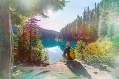 Hike in Canada. Hiking man in Canadian mountains. Hike is the popular recreation activity in North America. There are a lot of picturesque trails Stock Photo