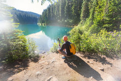 Hike in Canada. Hiking man in Canadian mountains. Hike is the popular recreation activity in North America. There are a lot of picturesque trails Royalty Free Stock Images