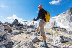 Hike. Hiking man in the mountains royalty free stock image