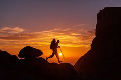 Hike. Hiking in  Norway mountains at sunset Royalty Free Stock Image
