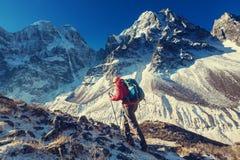 Hike in Himalayas. Hiker in Himalayas mountain. Nepal Stock Photo