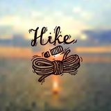 Hike logo. Hand- drawn hike logo on the nature background Stock Images