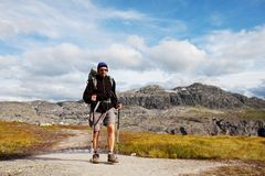 Hike in Norway. Men in hike in Norway mountains Royalty Free Stock Photos