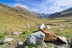 Hike to the three lakes of Tristaina, Andorra. Boulders in the vally of the three lakes of Tristaina (Estanys de Tristaina) in Andorra and the Ordino-Arcalis ski Royalty Free Stock Images
