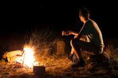 Hike tourist at a campfire Royalty Free Stock Image