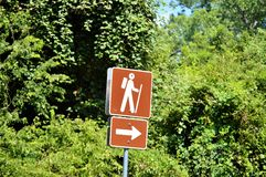 Hike trail signage leads to path Stock Images