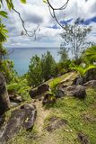 Hike the trail to anse georgettes on praslin on the seychelles royalty free stock photo