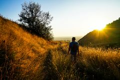 Trekking. Hike trekking on trail in mountains Stock Images