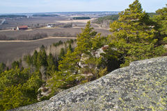 Hike up to Raven Rock. Raven rock (87 m) is a cliff situated in the forest in the municipality of Fredrikstad. On top of the cliff there is a magnificent view of Royalty Free Stock Photography