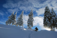 Hike in winter mountain. Hiker on the snow on winter Royalty Free Stock Photos