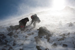 Hike in winter mountain. Hikers moving in snowy Kamchatka region, Russia Stock Images