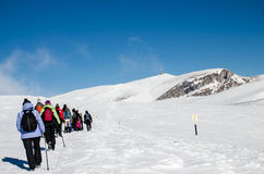 A hike in winter. People going on a winter hike on a snowy mountain plateau Royalty Free Stock Images