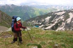 Hiker. Boy in Caucasus mountains Stock Photos