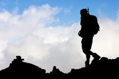 Hiker. Lonely hiker with blue sky Royalty Free Stock Images