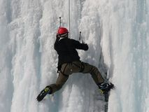 Hiker. Photo of hiker climbing the ice wall Stock Image