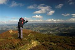 Hiker. With backpack is travelling in the mountains stock photography