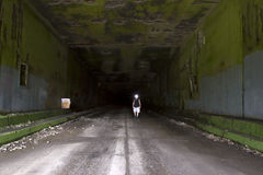 Hiker in abandoned tunnel Stock Image