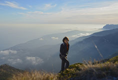 Hiker above clouds Royalty Free Stock Photo