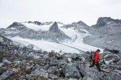 Hiker above Snowbird Glacier in Hatcher Pass area of Alaska, sum Royalty Free Stock Images