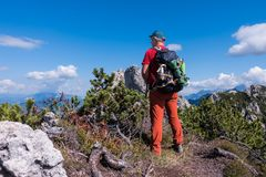 Hiker admire the mountain panorama of the peak.  stock images