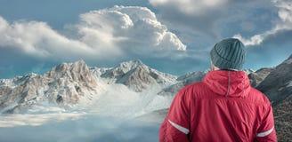 Hiker admire mountain scenery winter.  stock photos