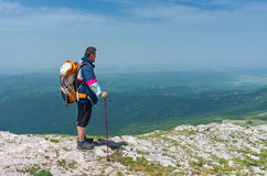 Hiker admires the scenery of the spring mountains Stock Photography